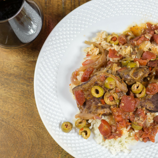 Pressure Cooker Spanish beef is deliciously tender and full of flavor! Olives, wine, tomatoes and Spanish chorizo come together to make sweet music!